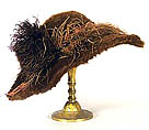 Victorian hat with feather on a stand